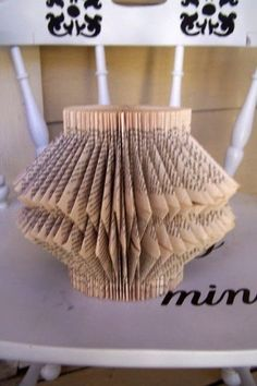 I am so excited to share one of my favorite tutorials from Loren Crane of Pandora's Craft Box.  This book folding art is a great way to upcycle an old book. Written By Loren Crane of Pandora's Craft B
