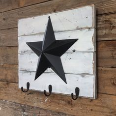White Distressed Wood Wall Hanging with 12 Inch Black Metal
