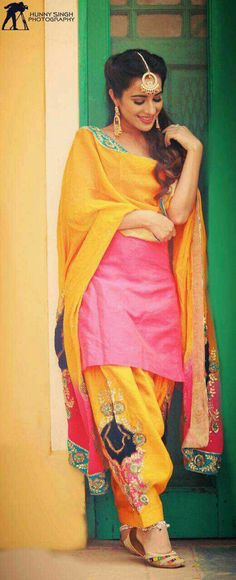 Yellow pink salwar suit with embroidery on salwar and dupatta lovely salwar suit Pakistani Suits, Indian Suits, Indian Attire, Indian Dresses, Indian Wear, Pakistani Dresses, Designer Punjabi Suits, Indian Designer Wear, Punjabi Fashion