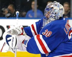New York Rangers goalie Henrik Lundqvist (30) blocks a shot by the Tampa Bay Lightning during the first period of Game 1 of the Eastern Conference final during the NHL hockey Stanley Cup playoffs, Saturday, May 16, 2015, in New York. (AP Photo/Kathy Willens)