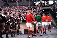 Manchester United 0 v Leeds United 0 Manchester United's Denis Law leads out his team before the match. March 1965