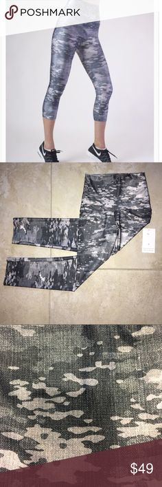 """Graphite Warrior Capri Workout Pants Seamless high waist. Can also be folded over for a low waist fit. Fabric molds to body and is quick drying. Made in USA. 82% polyester/18% spandex. Four way stretch.  small: 2-6 medium: 6-10 The inseam on capris is approximately 20"""" Please wash inside out in cold water; no bleach; hang or lay flat to dry.  Do not iron.  The spandex is sensitive so please avoid rough surfaces such as velcro, zippers, or concrete as the fabric will snag or pill when exposed…"""
