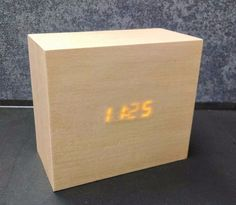 """I took an old DIY electronic clock kit, and built a sleek """"solid wood"""" housing for it. The LED display shines through wood veneer for a very nice effect."""