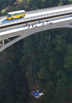 A jaccuzi suspended from 600 foot high bridge.