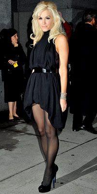 Gwen Stefani in a belted halter dress, a L.A.M.B. clutch, Lorraine Schwartz jewelry and patent peep-toe pumps.