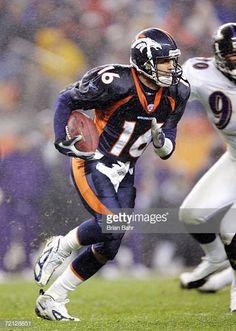 ea2f78242af Quarterback Jake Plummer of the Denver Broncos takes off running for a  first down on secondandfive
