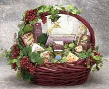 #81011 - Gourmet Gala Gift Basket - Large.   Send treats and goodies galore with our Gourmet Gala gift basket. Available in multiple sizes to fit any budget or any event, the Gourmet Gala brings good wishes and good food to enhance any event. The beautiful boat basket will make a gift to be enjoyed long after the event is passed. Sent the Gourmet Gala gift basket to someone you love. $89.99