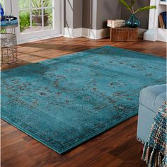 Update your decor with this transitional area rug. This stunningteal rug features an Oriental pattern that brings life to anyspace. Its large size makes it ideal for living rooms or bedrooms,and its s