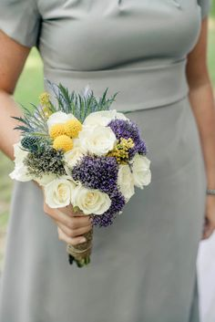 love the subtle use of yellow with solidago and billy balls with the purple trachelium and thistle!