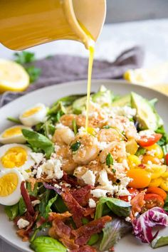 A cobb salad is always satisfying especially when it is topped with homemade garlic shrimp! This delicious salad is filling and the lemon vinaigrette makes it taste especially fresh! Salad Bar, Cobb Salad, Shrimp Recipes, Salad Recipes, Lemon Vinaigrette Dressing, Diced Chicken, Shrimp Salad, Garlic Shrimp, Kinds Of Salad