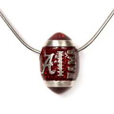 Football Necklace. I really want this but without any school on it for football season next year! I wish I could find one.