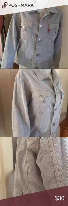 Levi iconic jacket Stylish Levi jacket. Silver/gray. Only worn once. Can fold cuffs up or wear them down. Levi's Jackets & Coats Jean Jackets