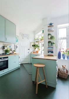 A Light Blue Danish Apartment Filled With Plants (Gravity Home) Mint Kitchen, Green Kitchen Cabinets, Kitchen Colors, New Kitchen, Kitchen Dining, Kitchen Decor, Blue Cabinets, Colored Cabinets, Orange Kitchen