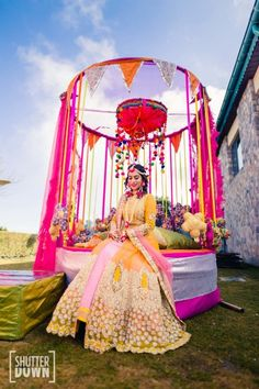 Mehendi Outfits - Bride in a Yellow and White Mehendi Outfit, Pink and Yellow Decor | WedMeGood | Photo by @shutterdown by Lakshya Chawla #wedmegood #indianbride #indianwedding #bridal #mehendioutfit #mehandi #decor