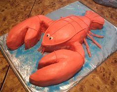 Lobster birthday cake! All buttercream, with hand made candy clay details!  All edible!  http://www.facebook.com/angelas.cakes2011