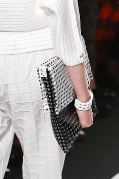ISSEY MIYAKE 2014 SS, self patterned / textured fabric, perforated cuff and bag