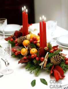 this attractive arrangement is stunning as a joyful Christmas centerpiece Fruity Christmas Candle Decor. this attractive arrangement is stunning as a joyful Christmas centerpiece for a large dining room table. Christmas Candle Centerpieces, Winter Centerpieces, Christmas Tablescapes, Christmas Candles, Centerpiece Decorations, Rustic Christmas, Xmas Decorations, Simple Christmas, Winter Christmas