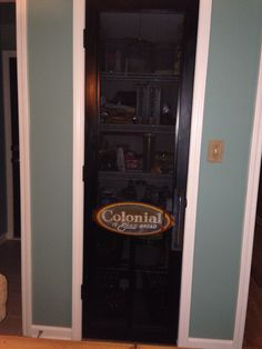 Pantry door - vintage Colonial bread sign I snagged from eBay; spurred an idea to have an old country store screen door. I remember one from my youth at my uncle's store ` good times. Screen from Lowe's and custom door frame made by husband's carpenter cousin!