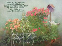 """""""Phlox of Late Summer"""" is an oil painting by Nancy Lee Moran of a country Victorian garden, where graceful scrolls of a decorative gate support tall phlox. The Victorian-colored (Painted Lady) birdhouse is from Nancy Lee's imagination.  Romantic Realism art copyrighted by Nancy Lee Moran USA, 12 x 16 oil on board, $1200 before framing #birdhouse #oilpainting #phlox #artlicensing #Surtex"""