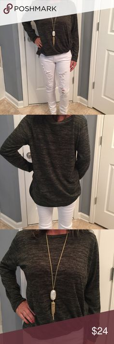 A BOUTIQUE MUST HAVE The perfect mixtures of grey! High/low with tie on side sewed to perfection! Goes great with jeans! Dress up or down Tops