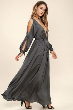 The Owning It Charcoal Grey Satin Maxi Dress has that bold look you've been craving! Sleek and slightly sheer charcoal grey satin shapes a deep V-neckline and billowing long sleeves with cutouts and tying cuffs. A drawstring waist with gold beaded ties tops a full maxi skirt. As Seen On Alice of @alis_jo!