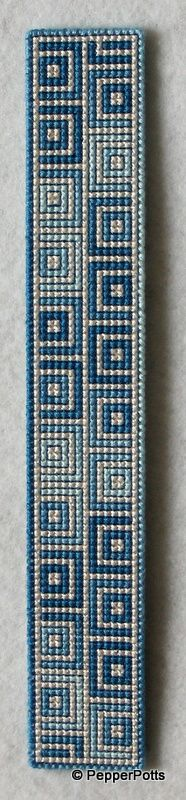 Worked on a scrap of 14ct plastic canvas in cross stitch. I first worked the pale lemon lines to delineate the squares. I then used a blue variegated stranded cotton for the filling in. It is backed with thin light blue craft foam held in place with double sided adhesive film.