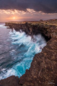 South Point by Ted Gore The southern most point in the United States on the Big Island of Hawaii. Waves beat the 50ft cliffs of the shore, formed of volcanic rock long ago.
