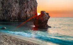 """Peeking Sun"" -- #wallpaper by ""Lowe Rehnberg"" from http://interfacelift.com -- The beach of Milos on Lefkada is only accessible by boat or a 20-minute hike over a mountain. This means you can enjoy the sunset all by yourself. Adobe Photoshop Lightroom 4, Adobe Photoshop CS5. -- Available as #wallpapers in any resolution at: http://interfacelift.com/wallpaper/details/3073/peeking_sun.html"