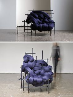 American designer Evan Fay, has created the Lawless Chair, a sculptural oversized seat made from steel rods and woven strips of dark blue upholstered cushions.
