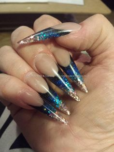 Stiletto nails with black, blue, green and pink glitters Taken at:6/3/2014 11:41:48 PM Uploaded at:6/4/2014 8:26:54 AM Technician:Elaine Moore