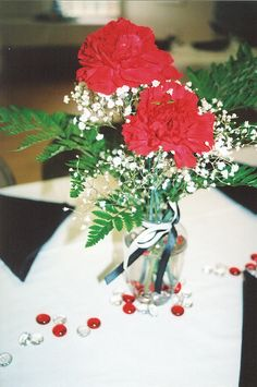 """Bride on a budget? You'll love this stunningly sharp arrangement in a """"Dollar Store"""" type bud vase. Carns, baby's breath, ferns ... a great complement for the red/white/black color wedding ! Under $12."""
