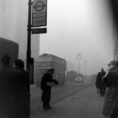Blind beggar in the London smog of 1947.
