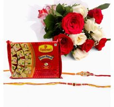 Bouquet of 10 White and Red Roses with Soan Papdi  and Set of 2 Rakhi