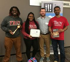 """The Campus Kitchen at Troy University recently received the Community Impact Award at the Food Waste and Hunger Summit held at the University of Arkansas. The Community Impact Award honors a Campus Kitchen that has made """"a measurable impact on food insecurity in their community and has put in the effort to track their outcomes."""" The Kitchen was recognized for starting and sustaining three community gardens and providing nearly 7,000 meals to those in need."""