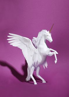 https://flic.kr/p/kHjyMH | Winged Unicorn Paper Model | Created by Ollanski for Nöjesguiden magazine, special issue. Blogged: www.allthingspaper.net/2014/03/commercial-paper-sculpture...