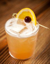 Solera Sour 1 1/2 oz. brandy 3/4 oz. simple syrup (1:1) 3/4 oz. fresh lemon juice 3/4 oz. fresh egg white (pasteurized if you like) Dash of Angostura bitters Garnish: brandied cherry