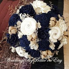 Navy Blue Sola Bouquet, Blue Champagne Ivory Bouquet, Wedding Flowers, Rustic Shabby Chic,Bridal Accessories, Keepsake Bouquet, Sola Flowers ****** Details ******* Beautiful all natural Sola Bouquet. Shown in navy blue, champagne and ivory. Made with natural ivory sola flowers,