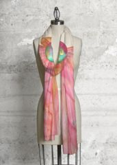 This scarf made with soft, luxurious fabric will add a bold, modern statement to any wardrobe.