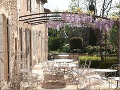 Image result for old french house curved metal pergola