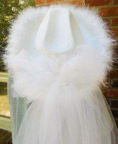 White felt light up cowgirl hat with white mesh veil used for Brides at their Bachelorette Parties Here in Nashville.