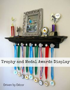 Attach decorative knobs to a ledge shelf for trophy and medal awards display: Attach decorative knobs to a ledge shelf for trophy and medal awards display