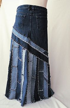 Reworked from a pair of previously loved blue jeans, this great long denim skirt features a diagonal cut yoke that is wonderfully figure flattering. Cut is a slightly flared a-line. Lower skirt has diagonal and vertical strip piecing to compliment the yoke. Strips are cut from plain and character parts from several pairs of blue jeans. Red stitching throughout adds a visual pop. - This listing is for a made to order long jeans skirt in the pictured style - Custom made in your personal…