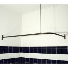 Curved curtain rods - what an awesome idea for a small bathroom!