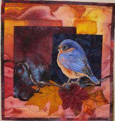 Thread painted blue bird quilt by Pat Jennings. Quilt Artists of Kentucky