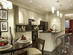how to decorate a kitchen with black appliances. How to coordinate white cabinets and countertops