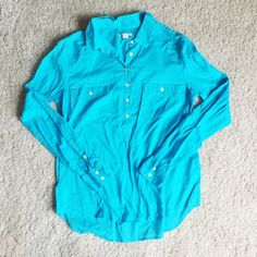 J. Crew Ink Dip Popover Like-new condition. Bright blue. Size 10.  Part button-down, part popover—we love this silhouette for its extreme casual chicness. The best part? It's garment-dyed in our favorite super-saturated brights to really amp up the color (and make the stitching pop). Cotton. Long sleeves. Machine wash. J. Crew Tops