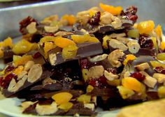 French Chocolate Bark from Ina Garten  Made three batches of this for gifts, super easy and impressive looking....WAY cheaper then the store bought stuff and you can choose any toppings you like. I made one with candy cane crumble, and dried cherries just for a change of scenery....