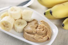 Dip slices of banana into peanut butter for a delicious before bedtime snack.