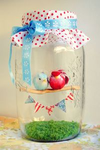 Fake grass and little stick to little birds you can create a little banner and some fabric and ribbon create this jar