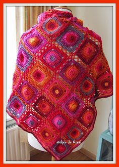 a very cheerfully coloured  crochet shawl